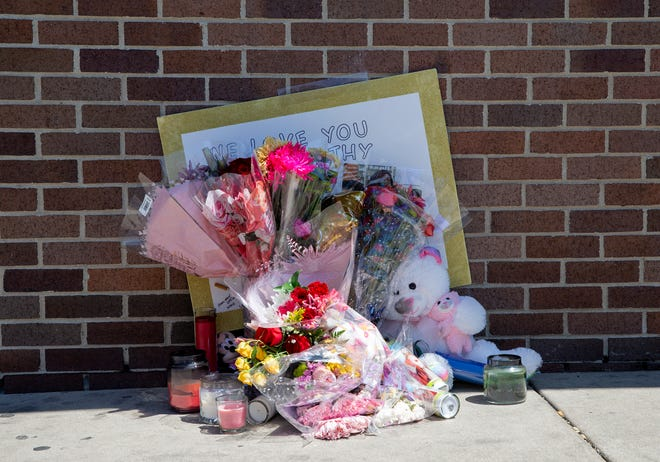 A memorial is set up outside the Walgreens for worker Cathy King, who was shot and killed in May outside the store at 2727 W. North Ave.