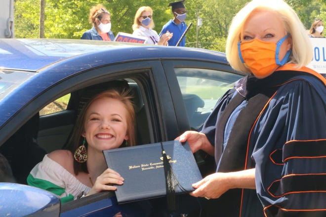Hundreds of graduates from the Class of 2020 at Wallace State Community College drove through campus Thursday morning to celebrate graduating from the college. An estimated 400 were greeted by cheering faculty and staff donning masks before stopping to receive a diploma cover and tassel from Wallace State President Dr. Vicki Karolewics.