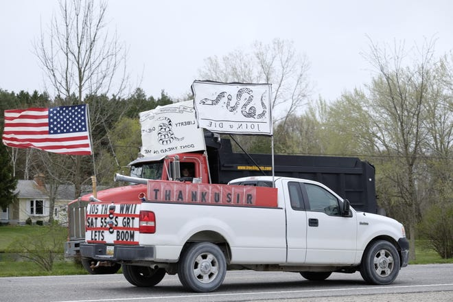 A pick-up truck participates in the drive-by birthday celebration for WWII veteran Walter Krupa on May 9, 2020, who turned 105 that same day.