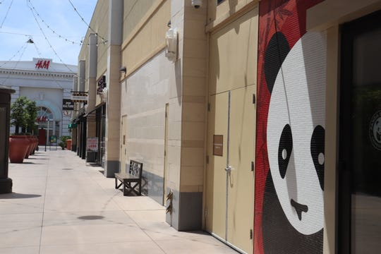 Many of the shops at Town Square, a popular outdoor mall in Las Vegas, remained closed on Saturday.