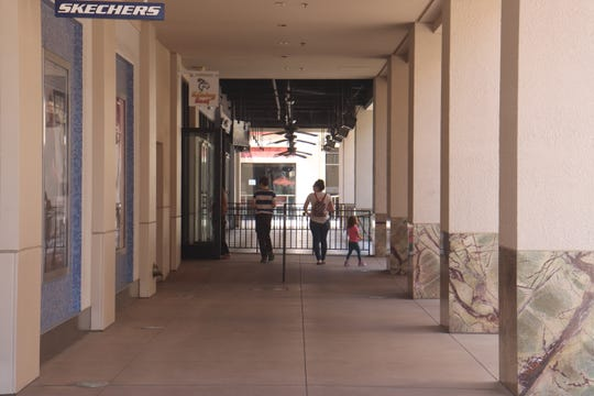 Shoppers walked around Saturday at Town Square, a popular outdoor mall in Las Vegas, to find anything that was open.