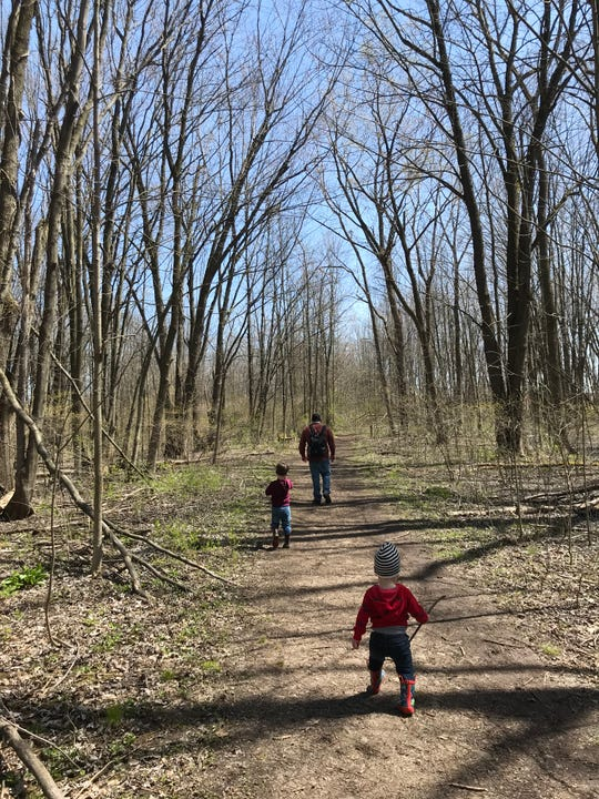 Jody Sebastiano hikes with his sons Joe, 3, and Luke, 19 months, at Thousand Acre Swamp in Penfield on April 26, 2020.