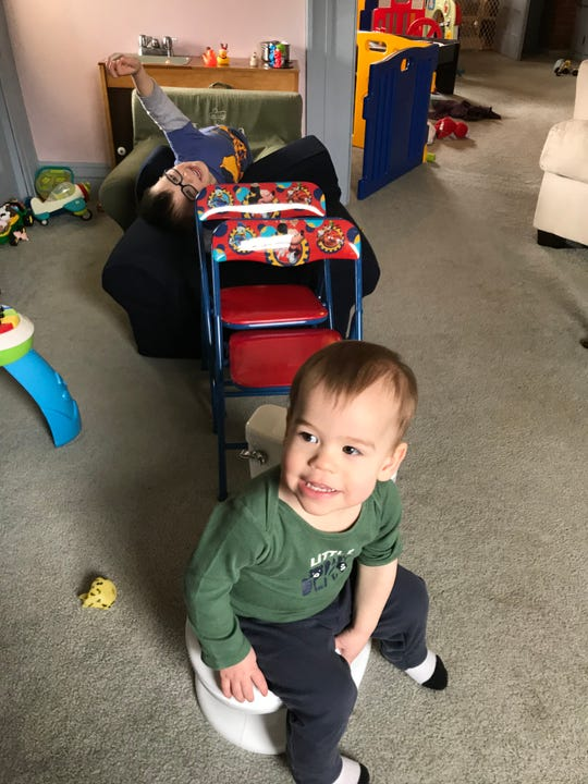 Reporter Victoria Freile's sons Joe, 3, and Luke, 18 months, building a train in March 2020.