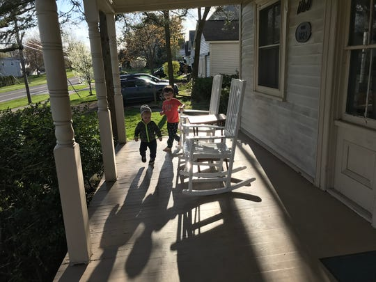 Reporter Victoria Freile's sons Joe, 3, and Luke, 20 months, chase each other around the porch on May 6, 2020.