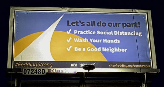 A billboard from the city of Redding encourages residents to be careful during the coronavirus crisis.