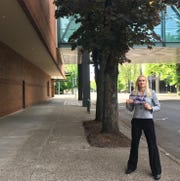Vanessa Nordyke with a pro-Reid Sund mailer. The mailer used an old photo of downtown Salem with homeless camps, which misleads voters into believing there are still these encampments downtown, Nordyke said. In this photo taken on Saturday, she is standing in the same spot used in the photos and said the sidewalks are clear.