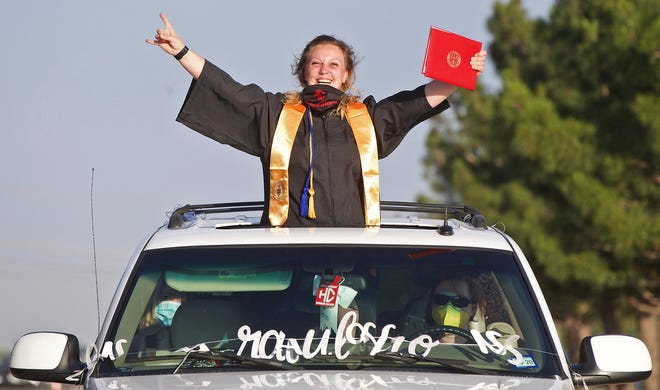 A Howard College graduate celebrates during a ceremony on campus Thursday, May 7, 2020. Graduates accepted diplomas from inside their vehicles during the drive though ceremony held according to social distancing guidelines due to the coronavirus.