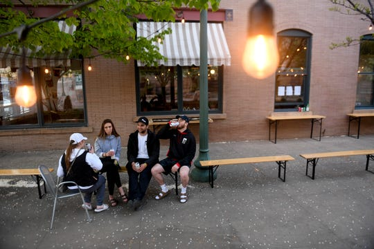 A group of friends have beers on Friday, May 8, 2020 at Fernson Brewing Co. in downtown Sioux Falls, S.D.