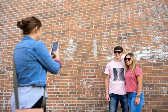 Nathaniel Post and Halle Jackson have their photo taken by Ashley Jackson on Friday, May 8, 2020 in downtown Sioux Falls, S.D. The group was waiting for their table at MacKenzie River.