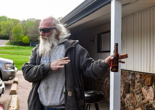 Craig Daggett has a conversation outside Silver Moon Bar on Friday, May 8, in Sioux Falls.