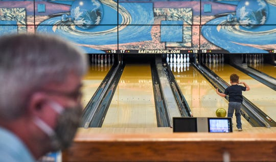 Eastway Bowl operates at half capacity on Saturday, May 9, 2020 in Sioux Falls, S.D. The bowling alley now requires employees to wear masks and has limited the amount of lanes open to adhere to social distancing.