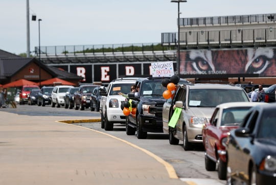 Cars carrying Republic High School graduates and family members line up to take part in the school's drive-through graduation ceremony on Saturday, May 9, 2020. The school's commencement was originally scheduled for this weekend but has been postponed to Aug. 1.