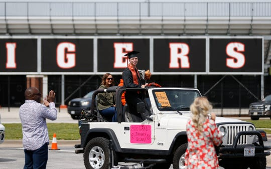 Republic High School senior Zachary Disney hangs out the top of a Jeep as he takes part in the drive-through graduation ceremony on Saturday, May 9, 2020. The school's commencement was originally scheduled for this weekend but has been postponed to Aug. 1.
