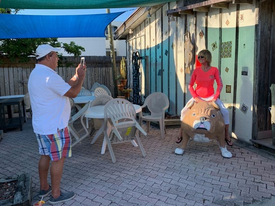 Joe Bostick takes Carol Martin's picture on a bulldog at the Driftwood in Vero Beach May 8, 2020. The Vero Beach couple planned to spend the Mother's Day weekend there with family.