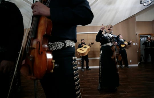 Karina Gonzalez, center, of Mariachi Tapatio, rehearses Friday, May, 8, 2020, for their Zoom private performances for Mother's Day. The group is booked solid from Friday night through Sunday.