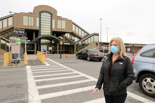 Kristine Gilligan, Deputy Village Clerk and Parking Manager for the Village of Croton-on-Hudson, discusses the sharp decline in parking revenue because of the pandemic May 8, 2020 at the Croton Harmon Train Station parking lot in Croton-on-Hudson.