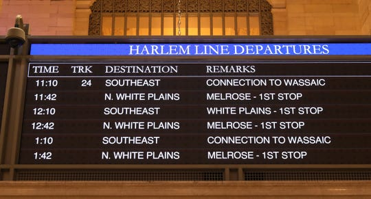 Train departure times and a single track in use is displayed for each of the three train lines for Metro-North Railroad, in an empty Grand Central Terminal, May 1, 2020.
