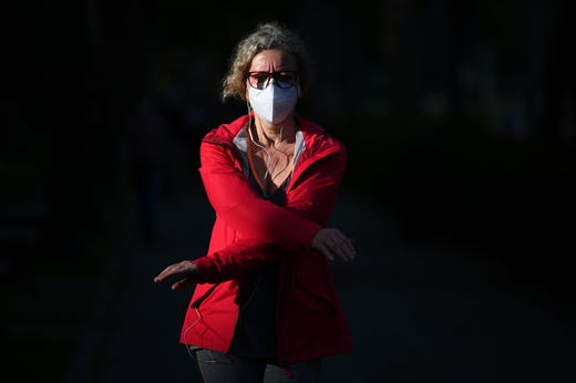 A woman weaing a face mask exercices in Madrid on May 9, 2020, during the hours allowed by the government to exercise, amid the national lockdown to prevent the spread of the COVID-19 disease. - Spain's two biggest cities Madrid and Barcelona will not enter the next phase out of coronavirus lockdown along with many other regions next week, the government said.