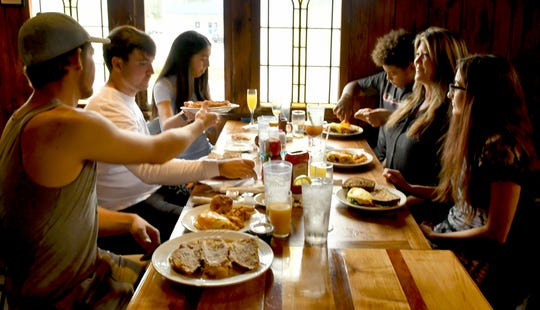 Lisa Moates, second from right, enjoys a Mother's Day meal with family and friends at one of her favorite places, Ashley's. The Rockledge restaurant is among the Brevard eateries having a partial indoor reopening.