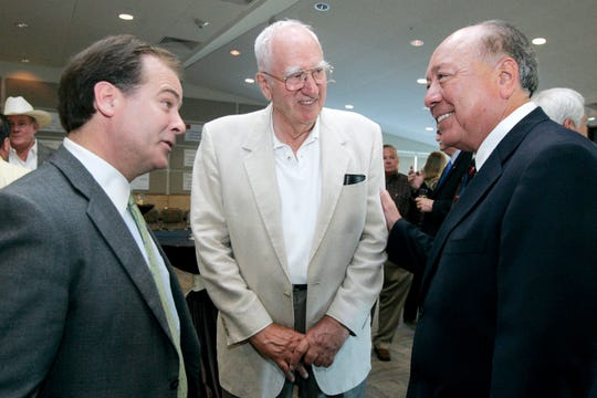 """Philanthopist Bernard Paulson (center) talks with state Sen. Juan """"Chuy"""" Hinojosa (right) and Fred W. Heldenfels IV, vice chairman of the Texas Higher Education Coordinating Board in this June 24, 2009 photograph. Paulson is oftencredited with being the driving force behind efforts to establish an engineering programat Texas A&M University-Corpus Christi.  He died May 5, 2020, at age 91."""