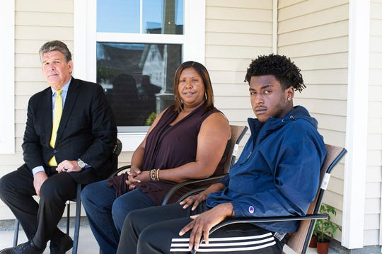 Dameon Shepard, right, his mother, Monica Shepard, and their attorney Jim Lea