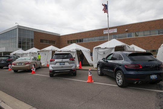 The cars of volunteers being tested for coronavirus-fighting antibodies in their blood pull up to several tents set up by Detroit Hatzalah EMS outside Yeshiva Beth Yehudah school in Oak Park Sunday.