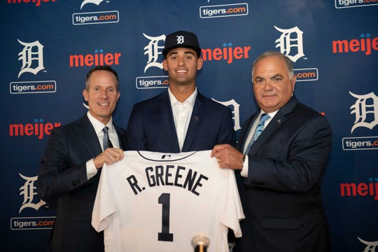 Chris Ilitch and Al Avila welcome Riley Greene after making him the Tigers' first-round pick in 2019.