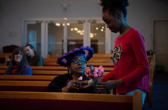 Pearlie Miller receives a pink rose from her great-granddaughter, Inspyir Walker, 10, at First Ebenezer Baptist Church in Evansville Sunday morning, May 10, 2020. The Mother's Day service was the first for the church in nearly two months since the stay at home order was put in place due to the COVID-19 pandemic.