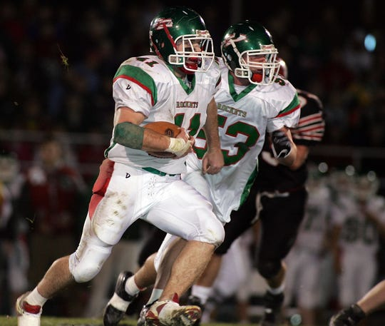 Oak Harbor's David Ulery carries the ball during a postseason game.