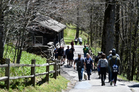 Visitors walk along the path to the restrooms at Newfound Gap in the Great Smoky Mountains National Park, Sunday, May 10, 2020. The park reopened some trails and destinations Saturday, May 9, after closing for an extended period to slow the spread of coronavirus.