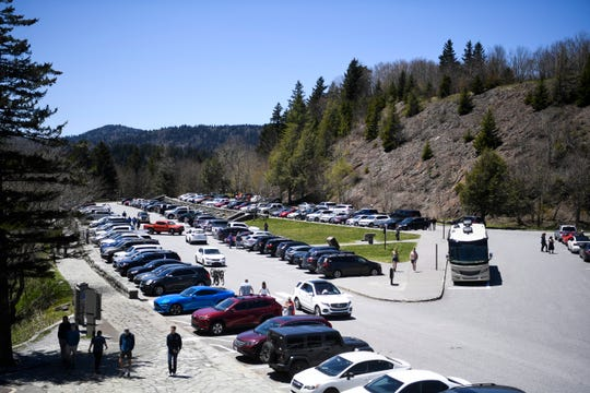 Visitors fill the Newfound Gap parking lot in the Great Smoky Mountains National Park, Sunday, May 10, 2020. The park reopened some trails and destinations Saturday, May 9, after closing for an extended period to slow the spread of coronavirus.