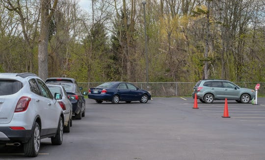 Parishioners at Saint Mary Catholic Church in Williamston wait in their cars to go to confession on Saturday, May 9, 2020.