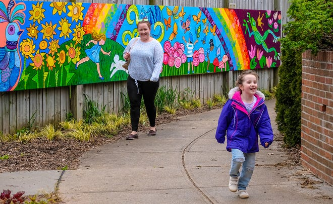 A child happily skips through the MSU Horticulture Gardens on Mothers Day Sunday, May 10, 2020.