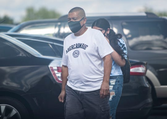 People wore face masks before they entered Wolfchase Galleria mall in Memphis on Sunday, May 10, 2020.