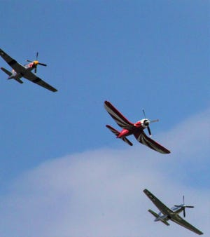 An F2G Super Corsair (in red and white) and two P51 Mustangs flew over the Mountain Home area Saturday afternoon.