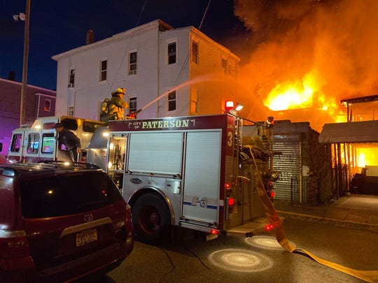 A fire on Beech Street in Paterson spread to multiple buildings May 9, 2020.