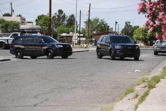 Las Cruces police close off Manzanita Street between Amador Avenue and Lohman Avenue with yellow tape on Sunday, May 10, 2020.