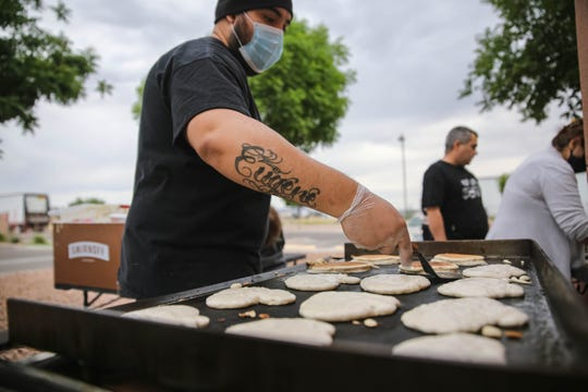 Israel Baca cooks bacon and pancakes to feed residents of the Mesilla Valley Community of Hope on Sunday, May 10, 2020.