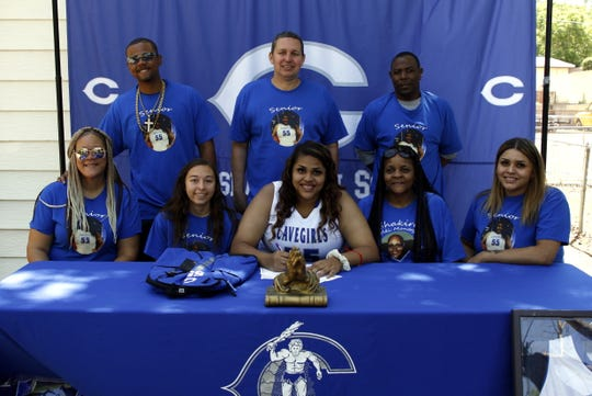 Kaliyah Montoya, center, signs her letter of intent to play basketball for Western Texas College on May, 9, 2020. Montoya finished her career with the Cavegirls being one of just two Carlsbad basketball players to make the state quarterfinals five straight years. She joined the 1,000-point club and was a First-Team All-District selection.