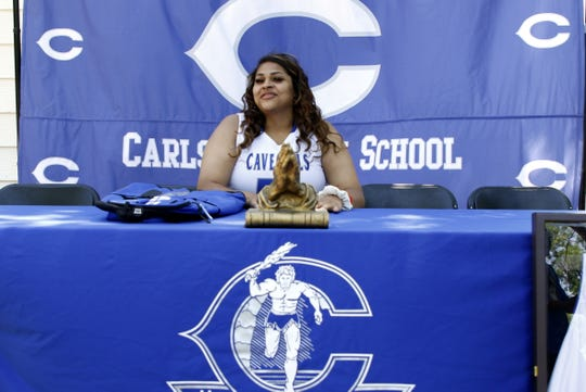 Kaliyah Montoya prepares  to sign her letter of intent to play basketball for Western Texas College on May, 9, 2020. Montoya finished her career with the Cavegirls being one of just two Carlsbad basketball players to make the state quarterfinals five straight years. She joined the 1,000-point club and was a First-Team All-District selection.