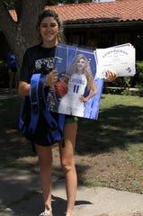 Carlsbad senior Taryn Tiller displays her awards during the Cavegirls Senior Basketball Celebration on May 9, 2020.