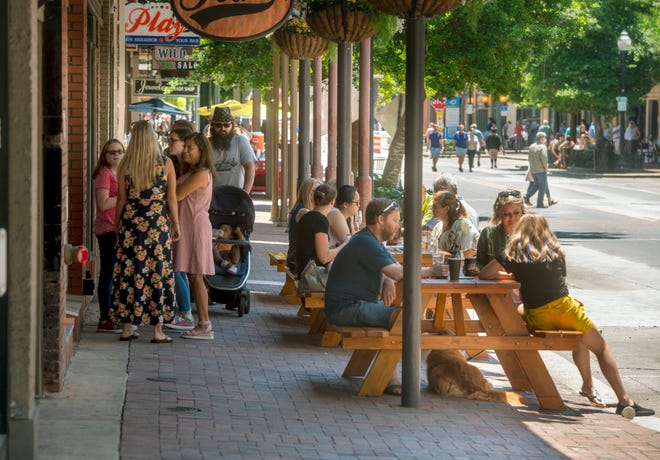 Visitors in downtown Pensacola take in the beautiful weather on May 10. Palafox Street from Garden to Main streets was converted to pedestrian traffic only for the Mother's Day holiday.