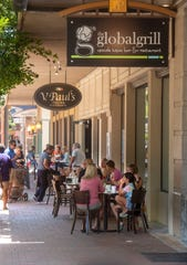 Visitors take in the beautiful weather Sunday as Palafox Street from Garden to Main streets was converted to pedestrian traffic only for the Mother's Day holiday.