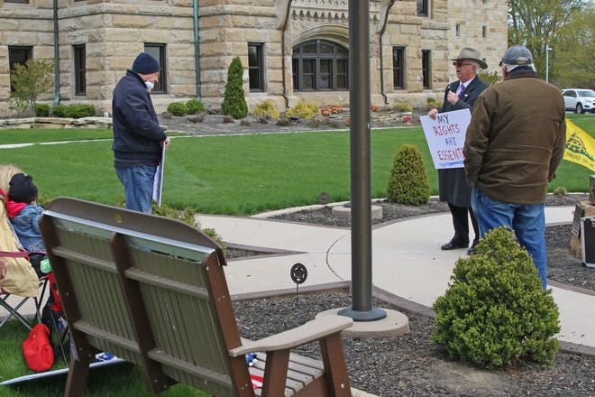 "A small group of protesters attended the ""Rally Around Ohio"" event at the Ottawa County Courthouse on Saturday, part of a chain of rallies held statewide."