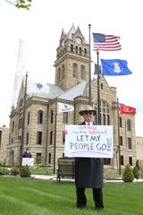 "Steve Kraus, leading the ""Rally Around Ohio"" protest at the Ottawa County Courthouse on Saturday, said, ""We have come to a place in our lives where we have somehow as a nation and as a government lost our way. Our God-given inalienable rights are being trampled on."""