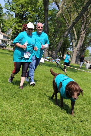 A view of two participants and their dog during the Animal Rescue Foundation's 5k run in May 2019.