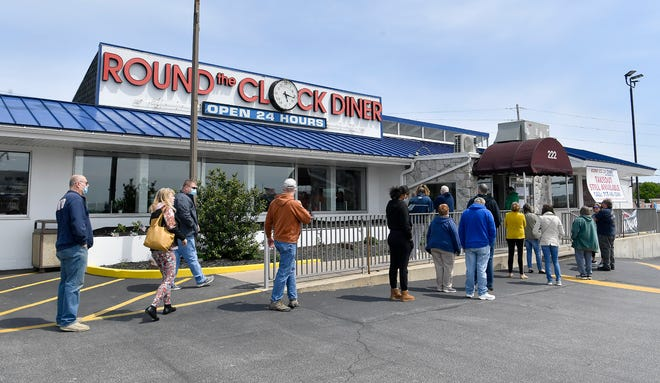 Customers wait in line outside Round the Clock Diner on Route 30, not only for take-out orders but also to have their first sit-down mean in a restaurant since the start of Governor Wolf's COVID-19 shutdown. After learning that the York County District Attorney's office would not enforce criminal penalties due to Governor Wolf's shutdown orders, Round the Clock Diner opened to eat-in customers Sunday, May 10, 2020. John A. Pavoncello photo