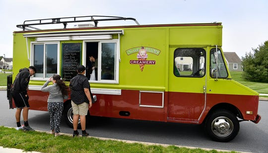 Brent and Allison Lebouitz visit the Ashley Farms neighborhood to offer their Sweet Willows Creamery ice cream, Sunday, May 10, 2020. John A. Pavoncello photo