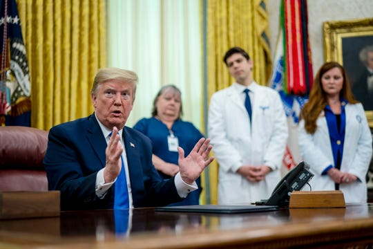 As the novel coronavirus pandemic continues in the United States, President Donald Trump talks to journalists after signing a proclamation honoring National Nurses Day in the Oval Office at the White House May 06, 2020 in Washington, DC.  (Doug Mills/Pool/Getty Images/TNS)