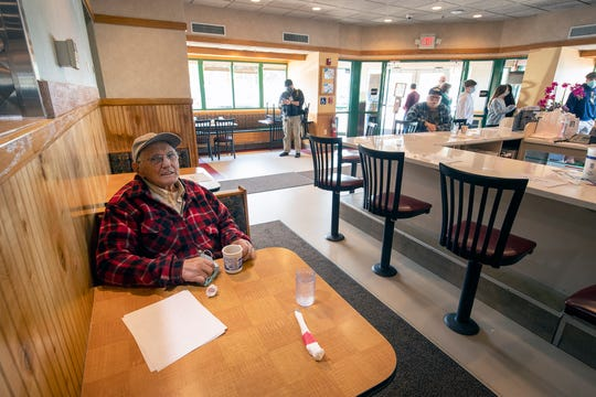 It was the first time Luther Snelbaker Jr. had a chance to sit in his favorite restaurant since the governor's orders closed businesses for sit-down service more than a month ago